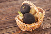 Black radish on a wooden table — Stock Photo