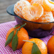 Stock Photo: Peeled tangerines on table