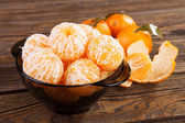 Peeled tangerines on a table — Stock Photo