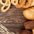 Bread assortment on a wooden table — Stock Photo #20953401