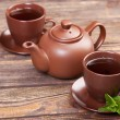Tea with mint on a wooden table — Stockfoto