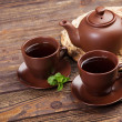 Stockfoto: Tea with mint on a wooden table