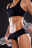 Slim woman with dumbbells — Stock Photo