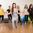 Stock Photo: Group training in gym of fitness center