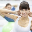 Cheerful young couple in a gym — Stock Photo #21151011