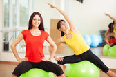 Group training in a gym of a fitness center — Stok fotoğraf
