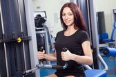 Beautiful slim woman training in a gym — Stock Photo