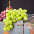 Stock Photo: Grapes on a wooden crate