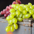 Grapes on a wooden crate - Stock Photo
