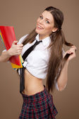 Woman in a schoolgirl costume — Stock Photo