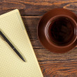 Stock Photo: Blank notepad on a wooden table