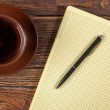Blank notepad on a wooden table — Stock Photo