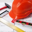 Construction tools on a blueprint — Stock Photo