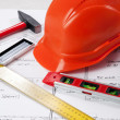 Construction tools on a blueprint — Stock Photo #24432889