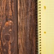 Notepad on a wooden table — Stock Photo #24447757