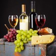 Wine, grapes and cheese — Stock Photo #24526573
