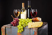 Wine, grapes and cheese — Stock Photo