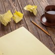 Stockfoto: Notepad on a wooden table
