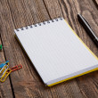 Notepad on a wooden table — Stock Photo