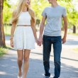 Stock Photo: Young couple walking in a park