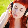 Stock Photo: Pretty girl listening to music