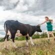 Young woman and a cow — Stock Photo #31194835