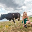 Young woman and a cow — Stock Photo #31194943