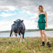 Young woman and a cow — Stock Photo