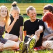 Students having fun in a park — Stock Photo
