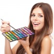 Beautiful woman holding a makeup palette — Stock Photo