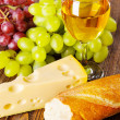 Wine, grapes and cheese — Stock Photo #32670651