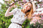 Beautiful woman in spring blossom — Stock Photo