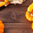 Fresh pumpkins on a wooden table — Stock Photo #33578085