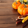 Stock Photo: Fresh pumpkins on a wooden table