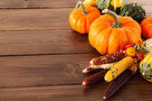 Fresh pumpkins on a wooden table — Stock Photo