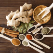 Spice assortment on wooden table — Foto de stock #35428693