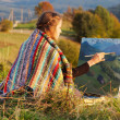 Young artist painting autumn landscape — Stock Photo #35906367