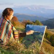 Young artist painting autumn landscape — Stock Photo #36119929