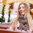 Beautiful young woman on a rollercoaster — Stock Photo