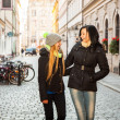 Two girl friends in the street — Stock Photo