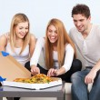 Group of young people eating pizza at home — Stock Photo #38208667