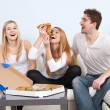 Group of young people eating pizza at home — Stock Photo #38208677