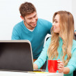 Stock Photo: Young couple working with laptop