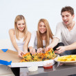 Group of young people eating pizza at home — Stock Photo #39800303