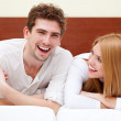 Young couple in bed — Stock Photo #39800657