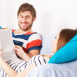 Stock Photo: Young couple reading books at home