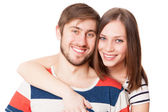 Young couple on white background — Stock Photo