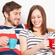 Young couple drinking coffee at home — Stock Photo #40523411
