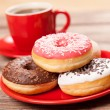 Stockfoto: Tasty donut with cup of coffee
