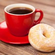 Tasty donut with a cup of coffee — Stock Photo #40847783